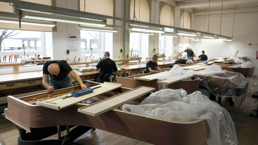 Technicians at piano manufacturer Steinway & Sons in Hamburg persevere with complex detailed work (Credit: Getty Images)