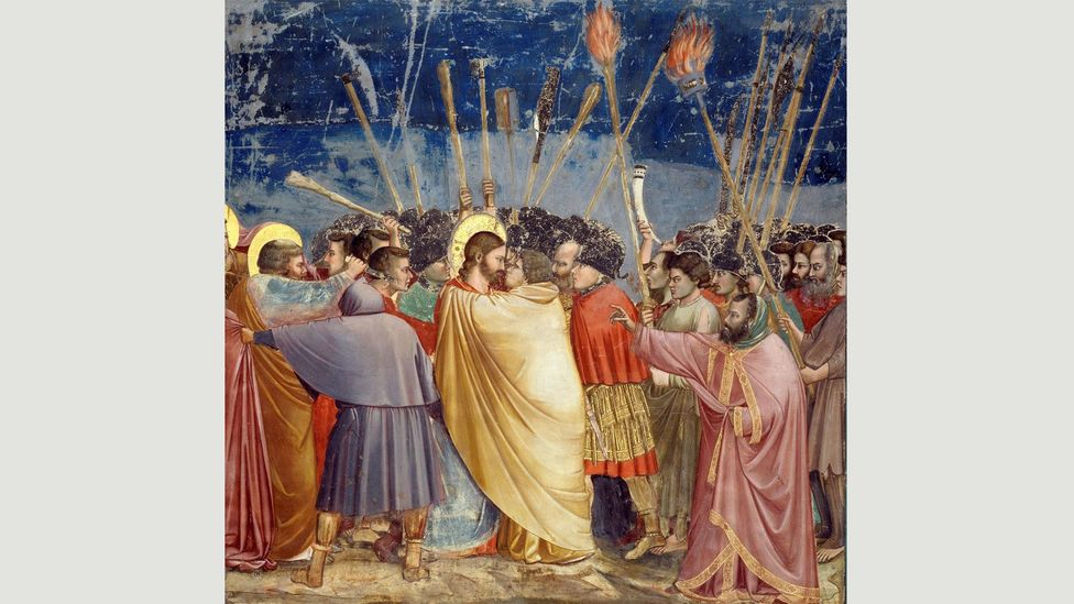Renaissance artists often painted Judas Iscariot in yellow, such as in this mural (1304-1306) by Giotto painted on the wall of a chapel in Padua, Italy (Credit: Wikimedia)
