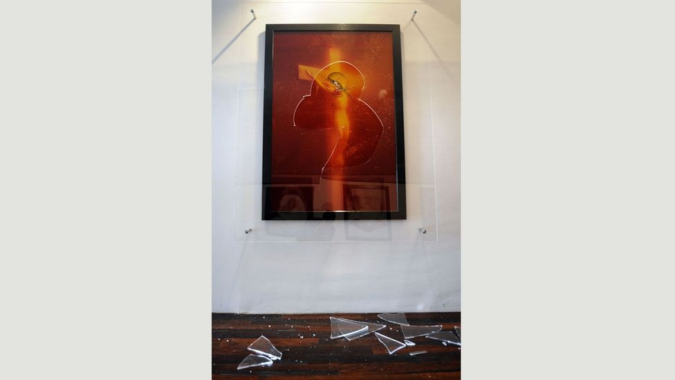 Andres Serrano's 1987 work, showing a crucifix submerged in a beaker of the photographer's own urine, was vandalised when exhibited in France in 2011 (Credit: Getty Images)