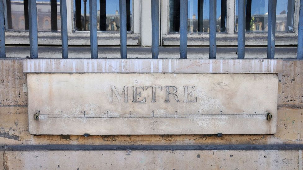 One of the last remaining 'mètre étalons', or standard metre bars, can be found below a ground-floor window on the Ministry of Justice in Paris (Credit: PjrTravel/Alamy)