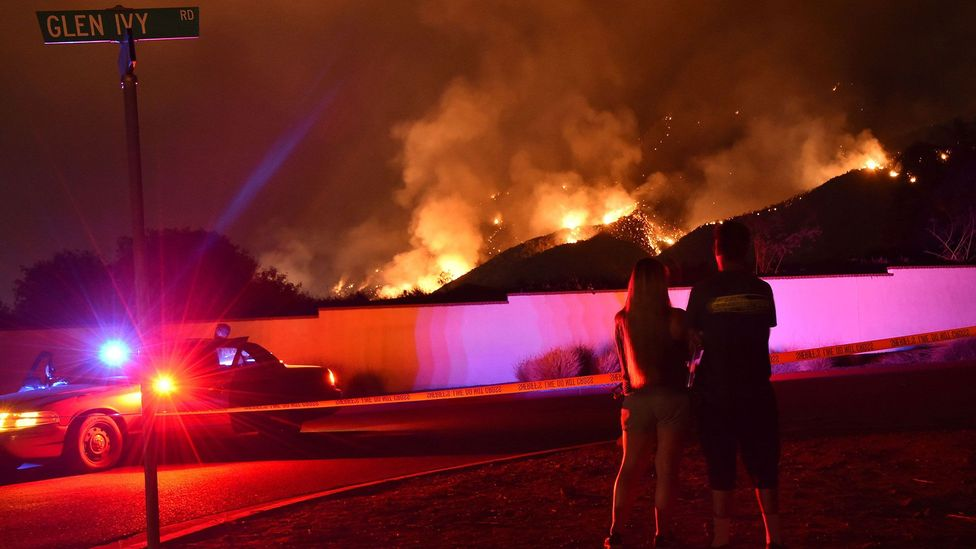 Onlookers observe the so-called Holy Fire in California in August 2018 (Credit: Robyn Beck/AFP/Getty Images)