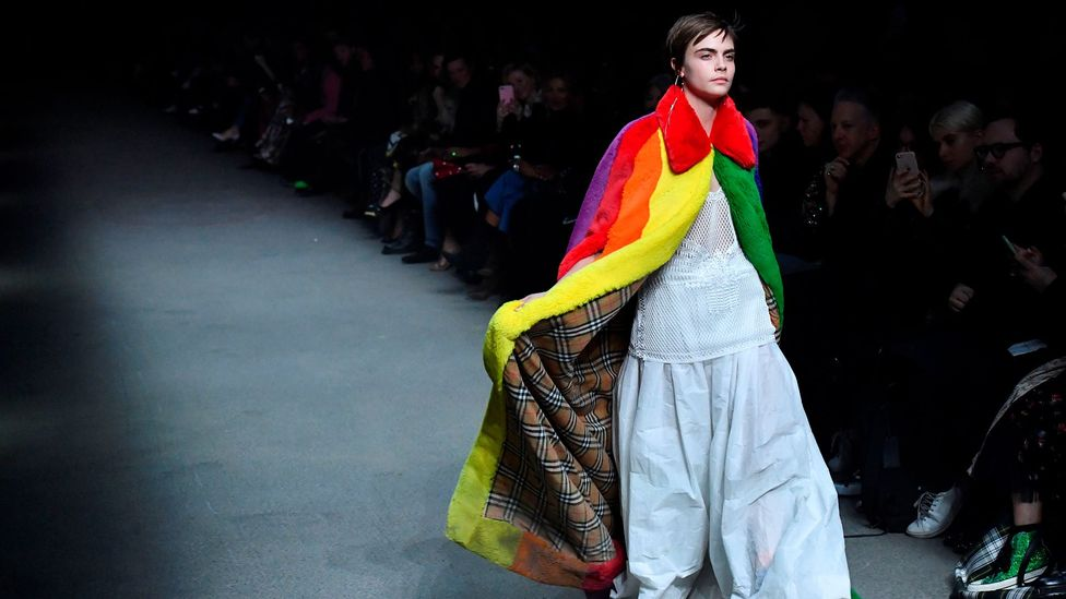 Burberry's faux-fur rainbow cape modelled by Cara Delevingne was the stand-out piece at the autumn/winter shows in London (Credit: Getty Images)