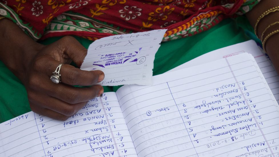 Fatima's registry helps her keep track of who has collected water from the tankers to ensure everyone gets their fair share (Credit: Lou Del Bello)