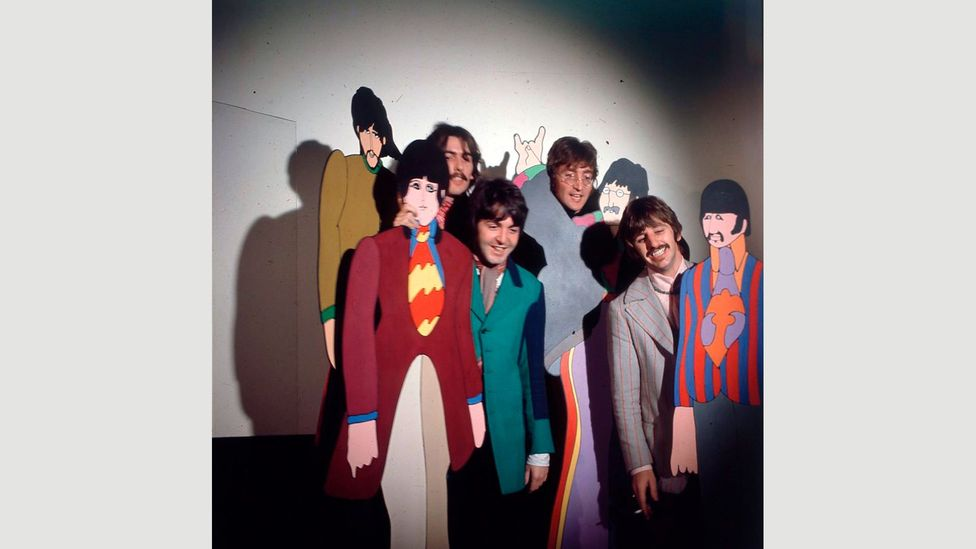 The Beatles posing with cardboard cut-outs of their Yellow Submarine characters in 1967 – its trippy visual style reflected the height of the psychedelic era (Credit: Getty)
