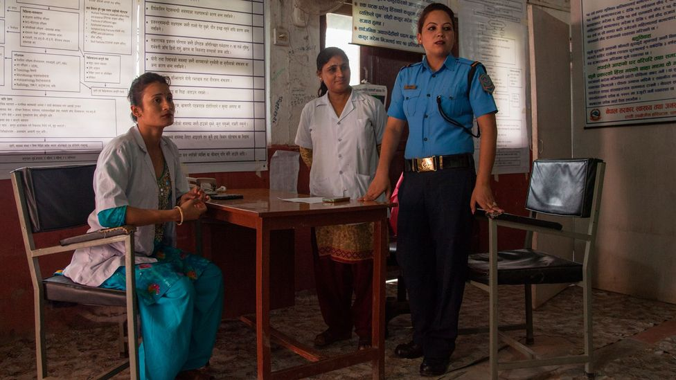 The team at the crisis management centre – staff nurse Punam Rawat, counsellor Radha Paudel and police officer Sabita Thapa – listens to a patient (Credit: Bunu Dhungana)
