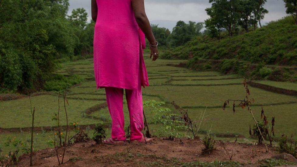 Neha, 38, waitsoutside a shelter home and knitting centre for survivors of intimate partner violence (Credit: Bunu Dhungana)