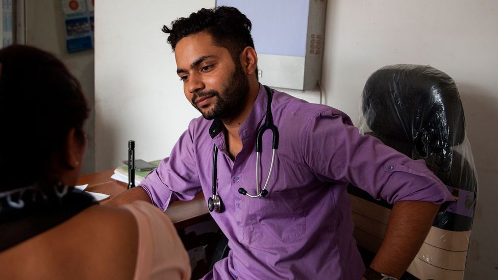Dr Prabhat Rijal meets a patient in the outpatient department; he regularly identifies intimate partner violence cases and refers them to the crisis centre (Credit: Bunu Dhungana)