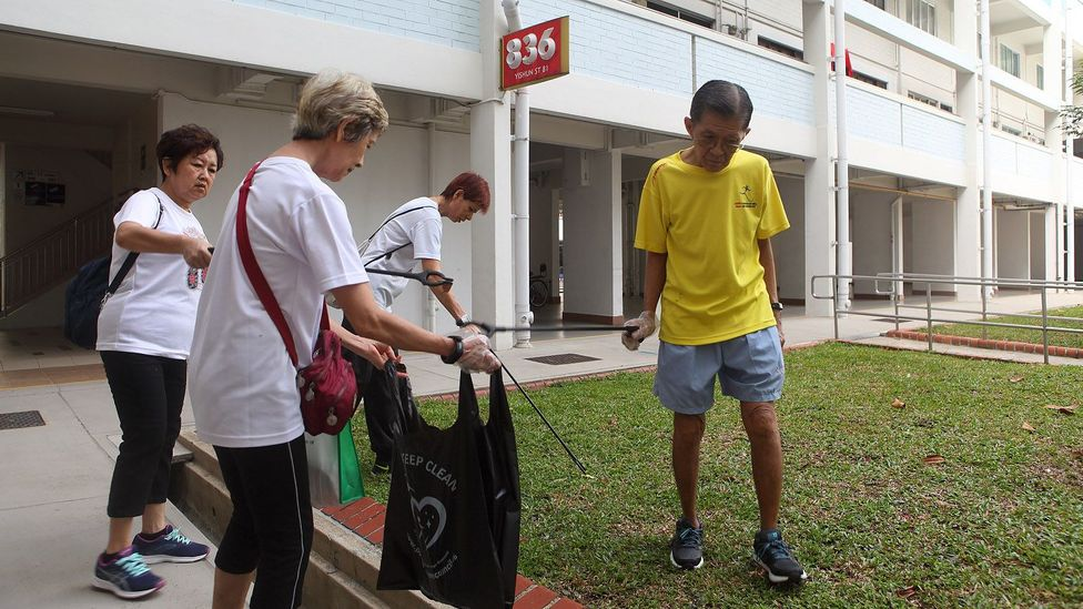 Volunteers at the Khatib clean up day although there are already 56,000 registered cleaners in Singapore (Credit: Tim McDonald)