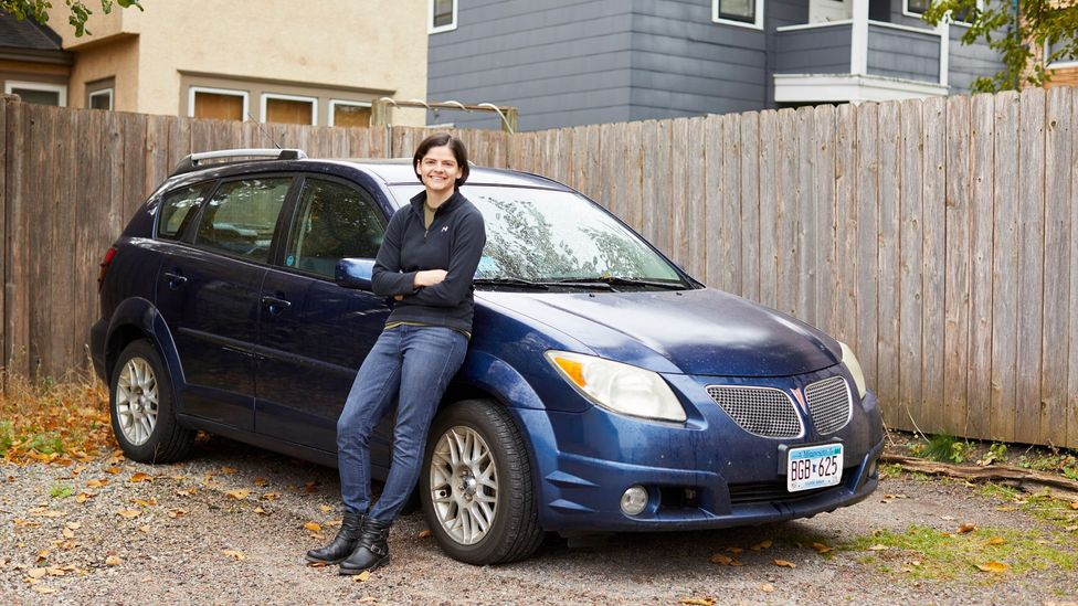Minneapolis resident Gwen Merz, 28, drives a 13-year-old car to help her stash away money for early retirement (Credit: Anna Radjl)