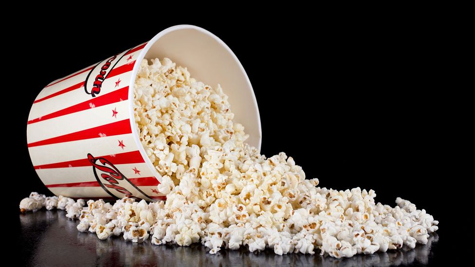 A large salted cinema popcorn (about 250g) can have about 5g of salt – nearly a day's worth, according to health guidelines (Credit: Getty)