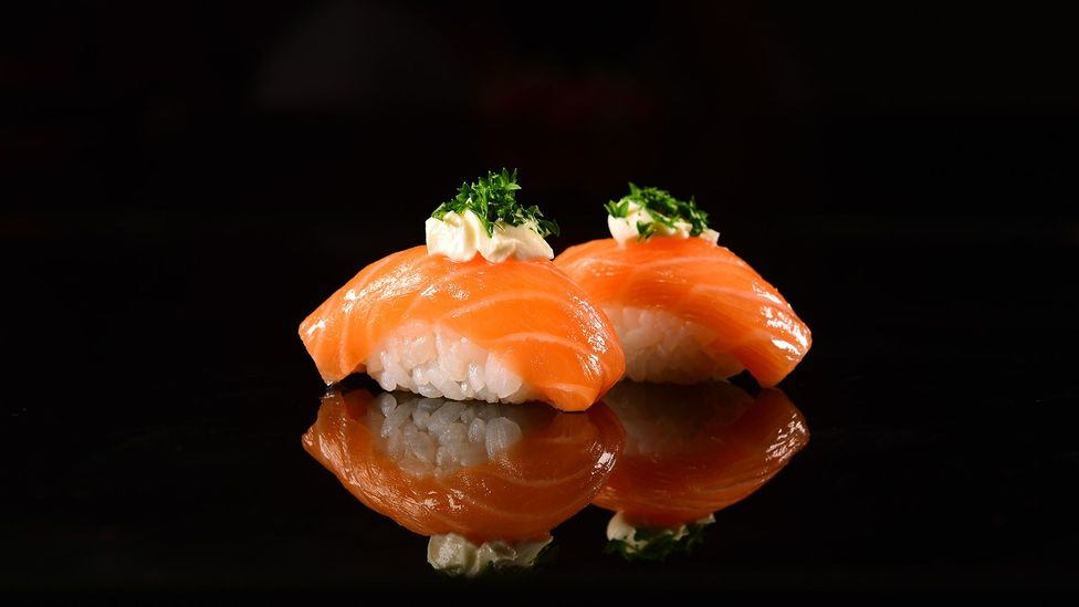 Two pieces of nigiri sushi contain about .5g salt – but 1tbsp of soy sauce adds another 2.2g, or 2.7g total (Credit: Getty)