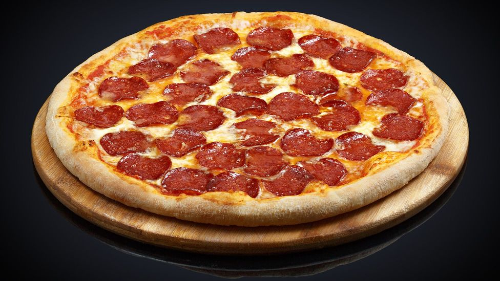 A single 100g slice of frozen pepperoni pizza can have 1.9g of salt (Credit: Getty)