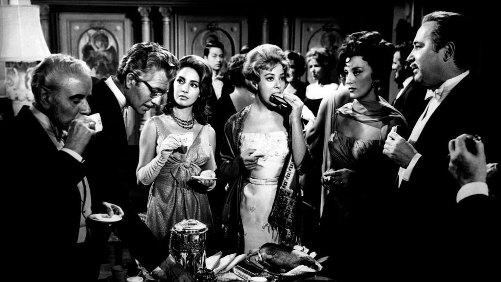 In The Exterminating Angel, a group of wealthy dinner guests inexplicably find themselves unable to leave their host's living room (Credit: Alamy)