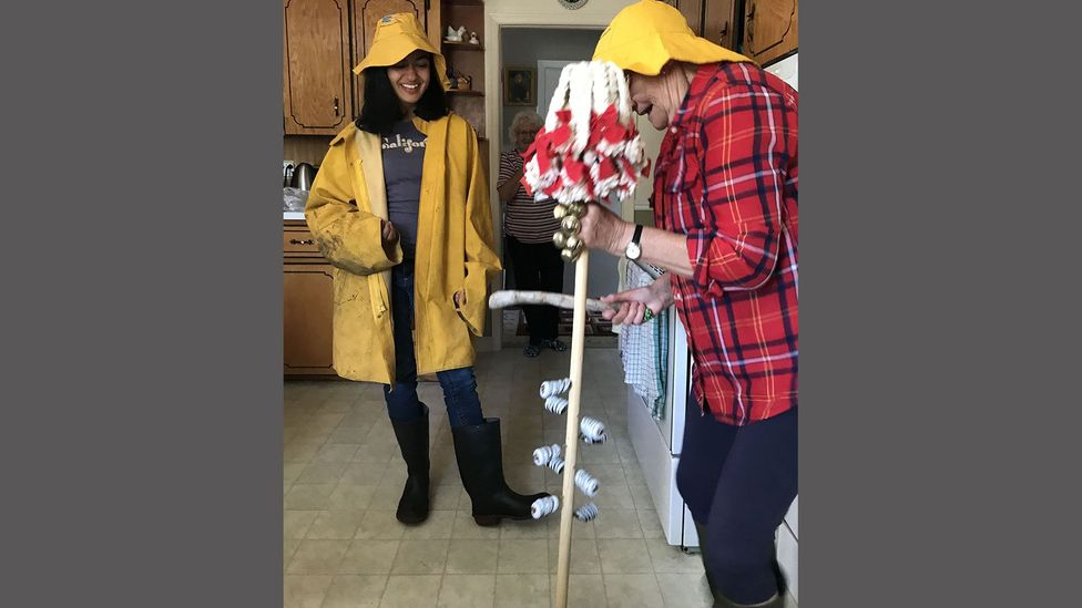Part of the screech-in ceremony involves a mop handle-turned-traditional Newfoundland musical instrument known as an 'ugly stick' (Credit: Suchi Rudra)