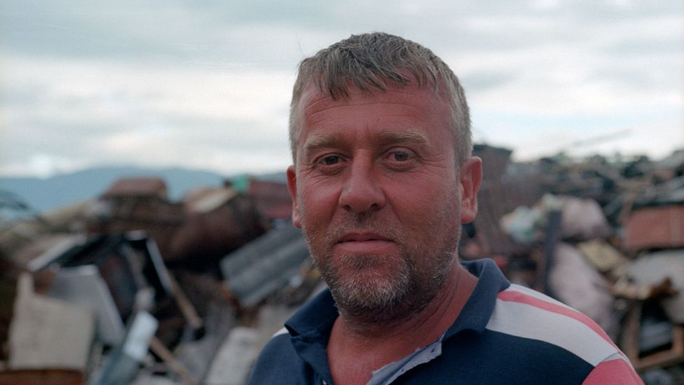Adi, who owns a scrapyard in Gjirokaster, breaks up the dissued bunkers (Credit: Stephen Dowling)