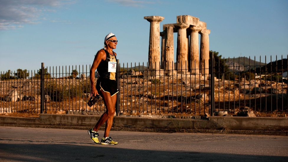 A runner in the 2013 Spartathlon slows while passing an ancient temple in Korinthos (Credit: Getty)