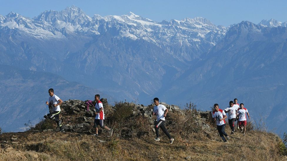 Nepali Buddhist monks train for an ultramarathon in February 2018 (Credit: Getty)
