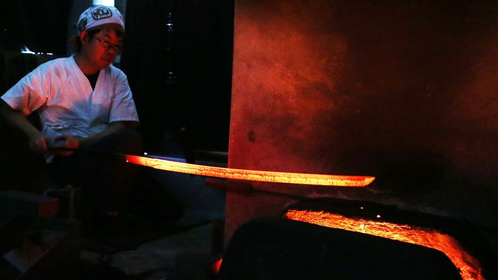 The tamahagane is heated and quenched many times as the swordsmith forges the blade (Credit: Getty Images)