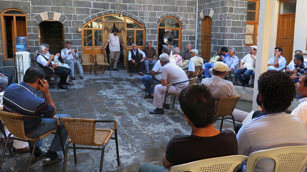 Members of Diyarbakır's Kurdish community gather at Mala Dengbêjan to listen to the dengbêj singers' kilams, or songs (Credit: Terry Richardson)