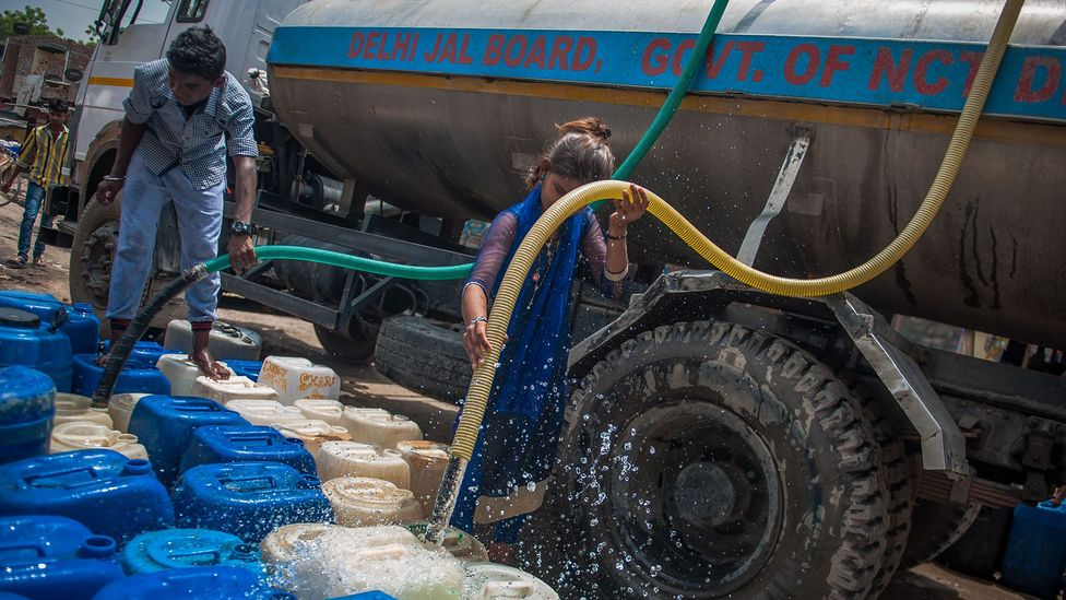 Delhi's slums rely upon regular tankers to deliver water to the residents but shortages and disputes can interrupt the supply (Credit: Getty Images)
