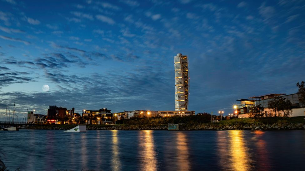 The Turning Torso tower is a 54-floor residential block that over looks the bridge it was built to symbolise Malmo's new thriving economy (Credit: Alamy)