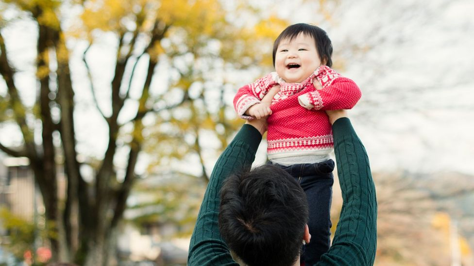 In the past, Japanese fathers were considered to be remote and stern, but the new 'ikumen' actively take pleasure in childcare (Credit: Getty Images)