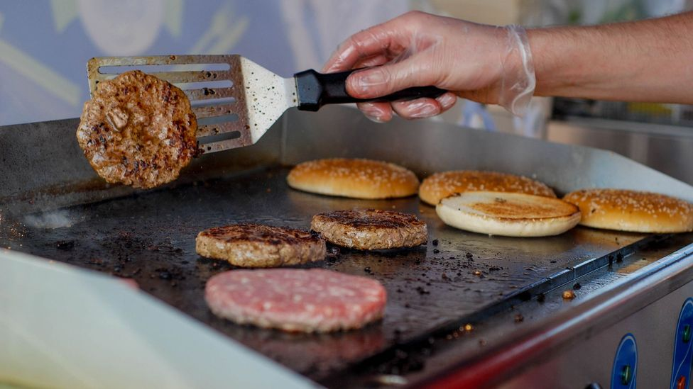 Equipped with a range of sensors, robots are more accurate than human chefs at judging whether a burger has been cooked through (Credit: Getty Images)