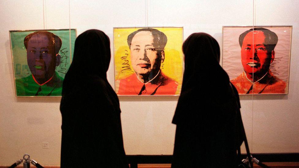 Visitors view Andy Warhol's portrait of Mao Tse-tungat TMoCA (Credit: Getty Images)