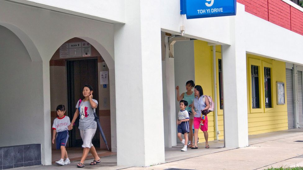 """""""I don't lock my door, I make it a point to know my neighbours,"""" says Safura Ashari, an estate agent who helps clients find HDB units (Credit: Alamy)"""