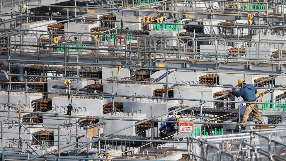 As Tokyo barrels toward the 2020 Summer Olympics, labour shortages in venue construction have demanded help from workers abroad (Credit: Getty Images)