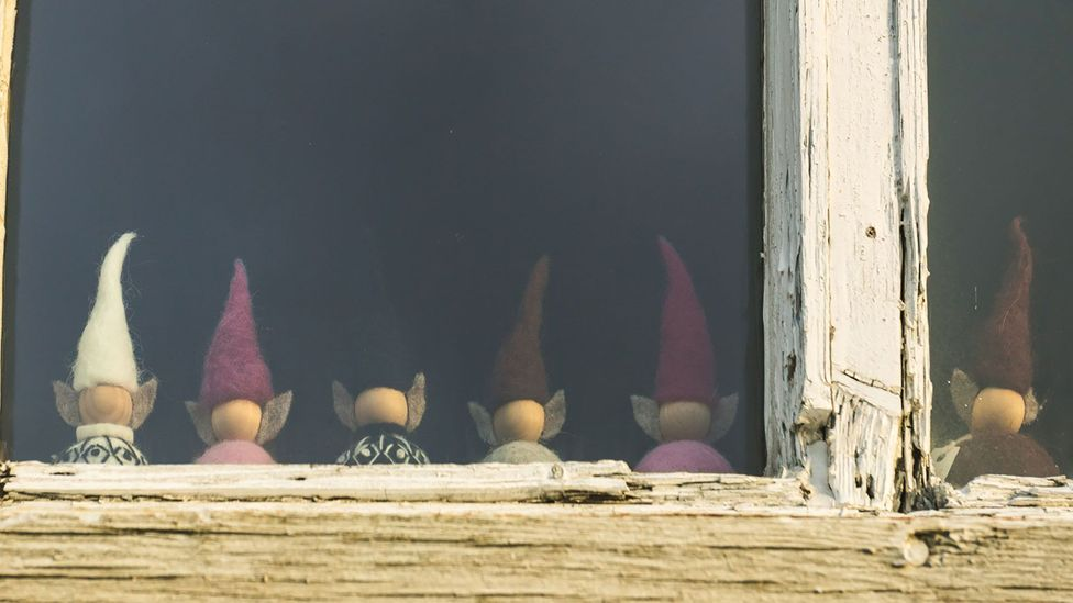 Toy elves in the window of a house in Iceland