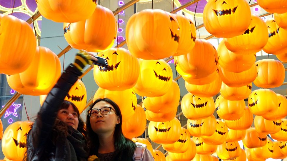 Halloween jack o' lanterns in Zhengzhou, China. Autumn has seen investor behaviour become both more optimistic and pessimistic in the past (Credit: Getty Images)