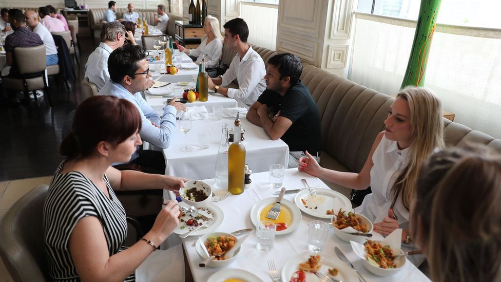 Emirati and foreigners eat at a restaurant in Dubai on August 30, 2018 (Credit: Getty Images)