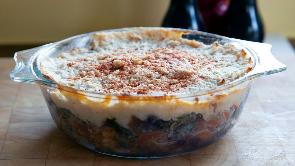 """The AI mixed leftover sausages wrapped in bacon, bread sauce and red cabbage together to create a """"Spanish potato casserole"""" (Credit: Richard Gray)"""