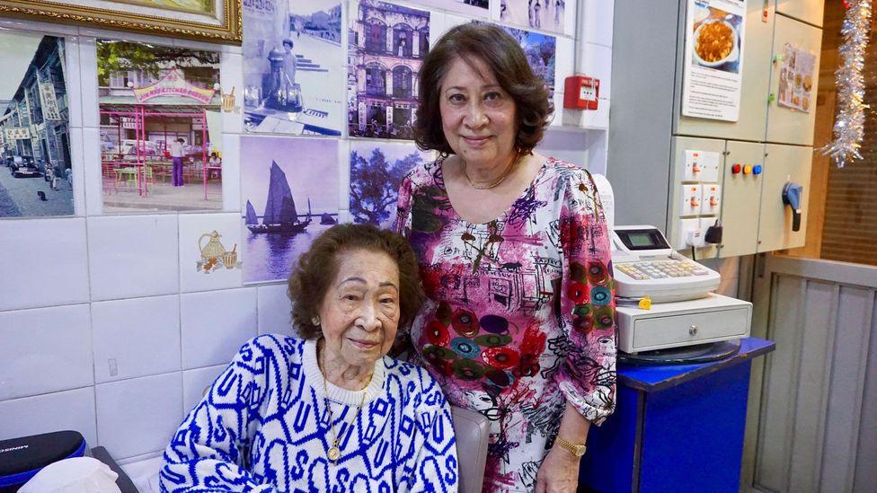 Often dubbed 'the godmother of Macanese cuisine', 103-year-old Aida de Jesus (left) opened the first Macanese restaurant in Macau (Credit: Matthew Keegan)