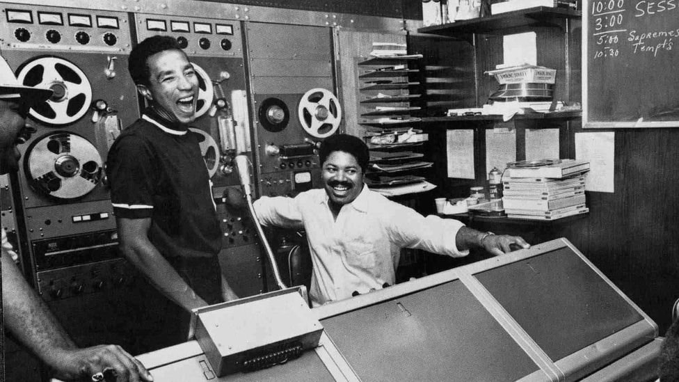 Smokey Robinson laughing in a sound booth