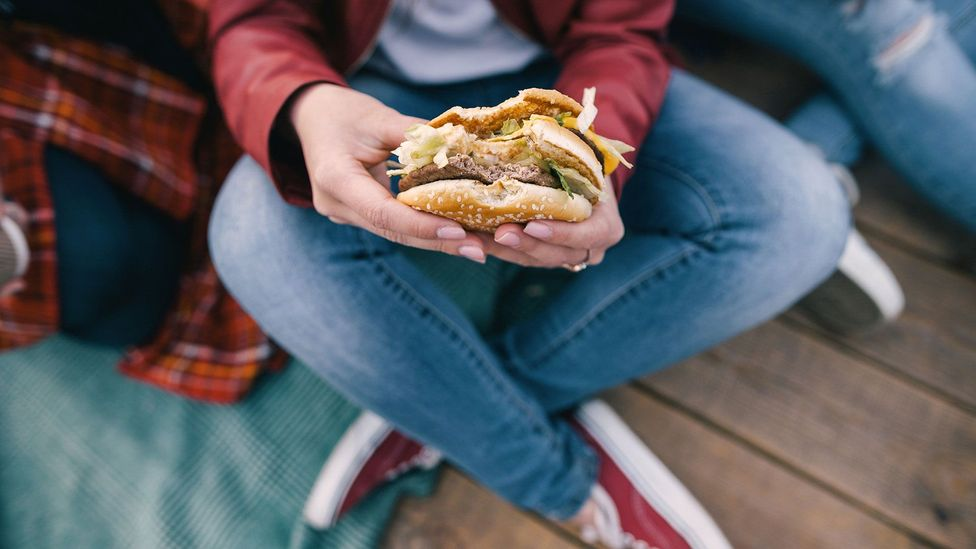 As well as non-food related factors, we're also up against temptations like large portion sizes and high fat meals (Credit: Getty)