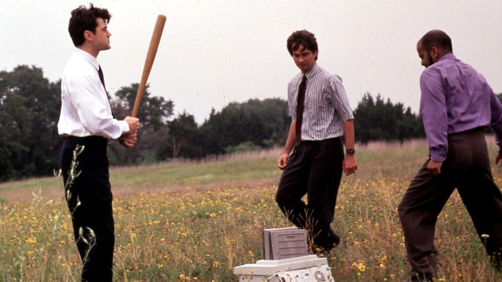 The three lead characters of Office Space take their aggression on their office printer, a symbol of their officeplace anguish (Credit: Alamy Stock Photo)