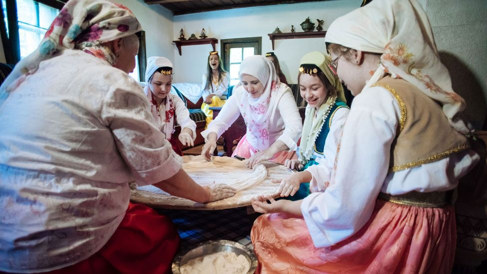 Ćetenija is traditionally made during 'sijelo', or sitting parties, while other guests play traditional music and cheer for the ćetenija-makers (Credit: Haris Calkic)