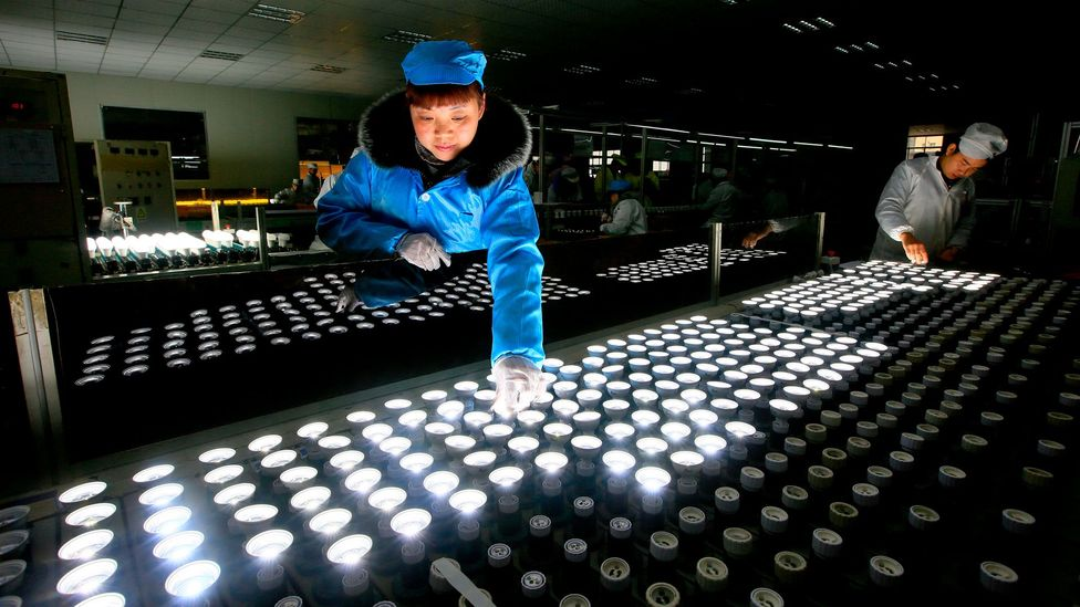 An energy-saving bulb production line at a lighting factory in Suining, southwest China's Sichuan province (Credit: Getty Images)