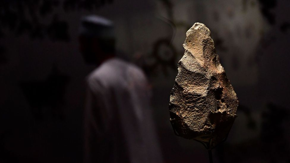 A hand-axe, estimated to be 2 million years old, at a museum in Muscat, Oman (Credit: Getty Images)