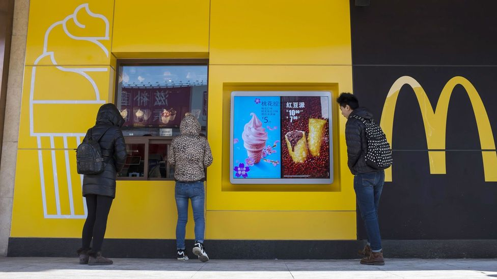McDonald's allows its customers in China to order food by typing 4008-517-517.cn, because '517' in Mandarin sounds like 'I want to eat' (Credit: ZUMA Press, Inc./Alamy)