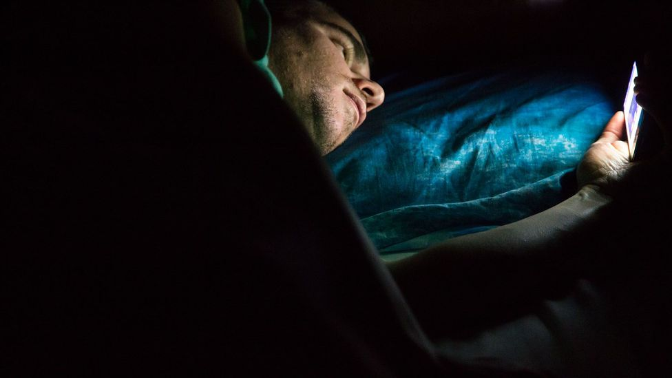 Humans aren't built to go to sleep with glowing distractions, which can cause sleep problems (Credit: Getty Images)