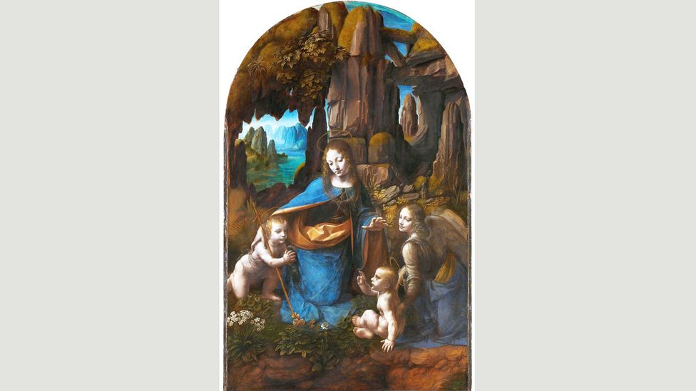 In what is thought to be the second version, Da Vinci added haloes and painted John the Baptist with a cross (Credit: National Gallery)