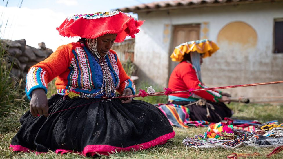 Peruvian women use traditional weaving techniques to make products for a not-for-profit social enterprise (Credit: Getty Images)