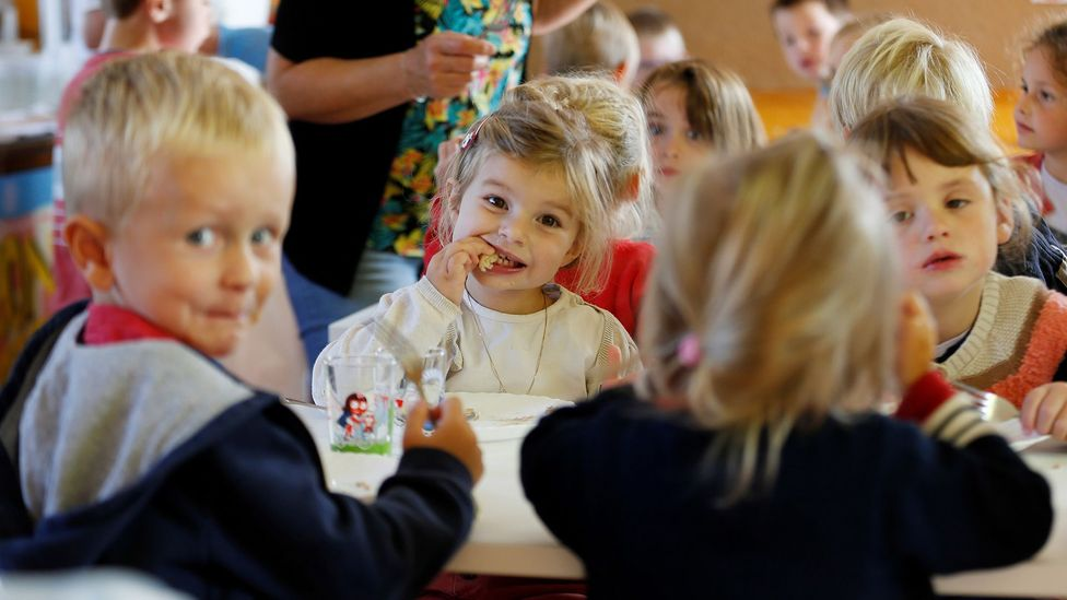 Children have lunch at the canteen of Courtonne-la-Meurdrac elementary school in France, which serves organic food exclusively (Credit: Getty)