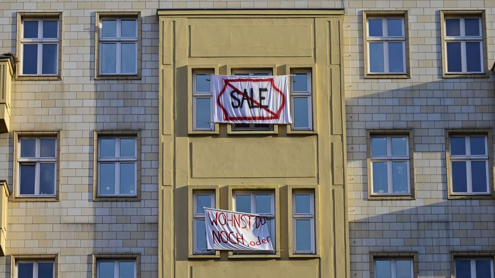 Tenants protest the sale of apartments on the most prominent boulevard in old Communist East Germany to Berlin's largest property company (Credit: Getty Images)