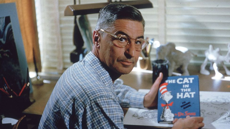 Dr Seuss with his book The Cat in the Hat, pictured in 1957 (Credit: Getty)
