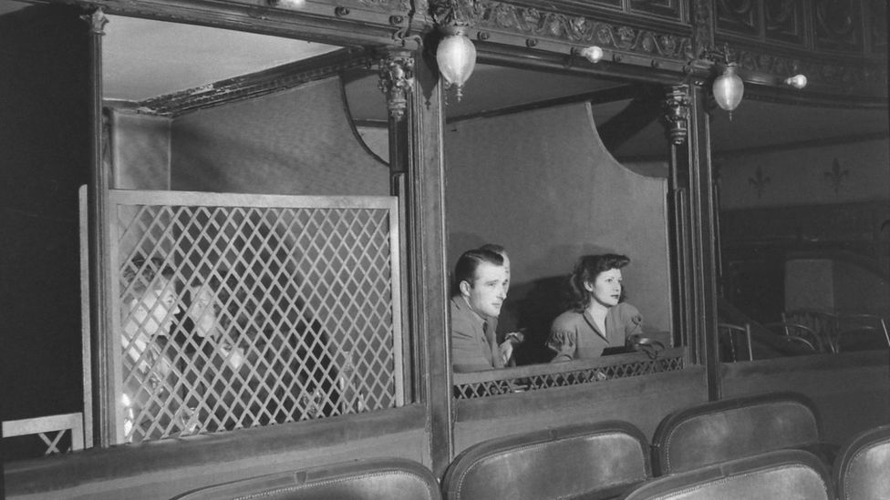 There were private boxes at the back of the theatre which allowed patrons to see out, but no one could see in (Credit: Getty Images)