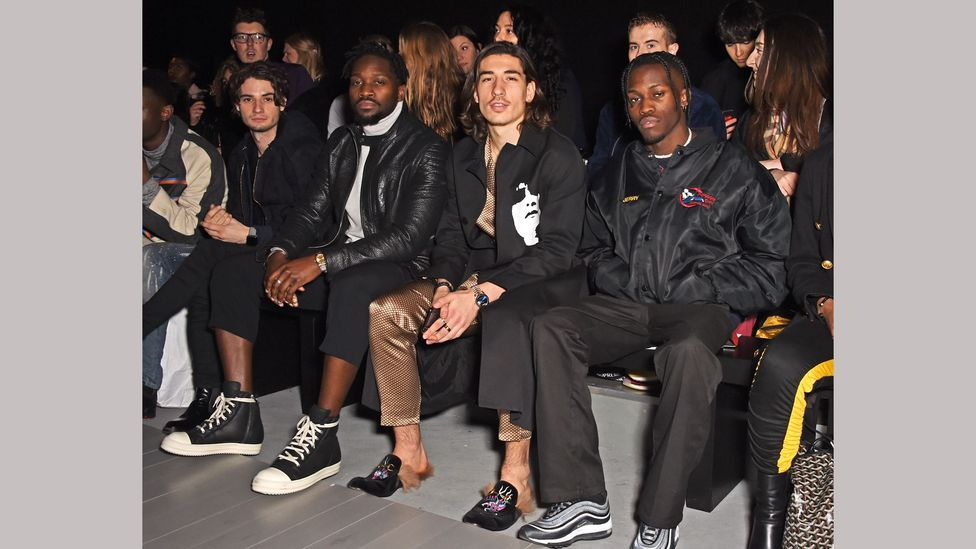 At a recent London Fashion Week, footballer Héctor Bellerín sported silk pyjamas and furry Gucci mules (Credit: Getty Images)
